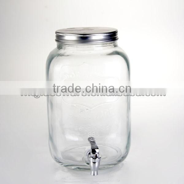 huge glass mason jar with a tap