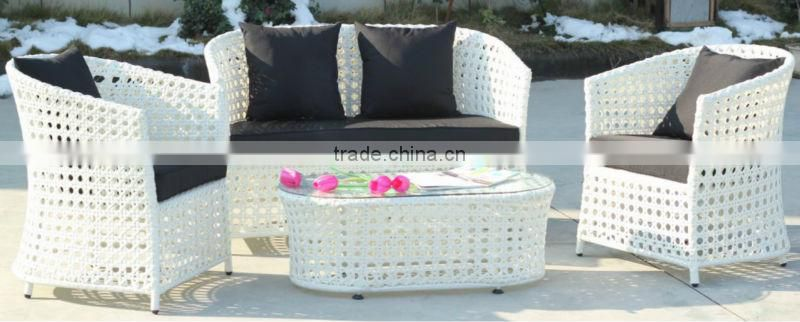 white wicker table and chair
