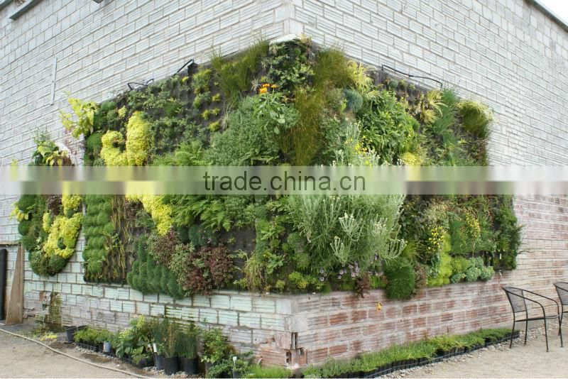 artificial plant wall with leaves/flowers/grass