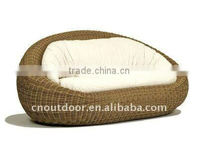 Round and comfortable rattan outdoor sofa