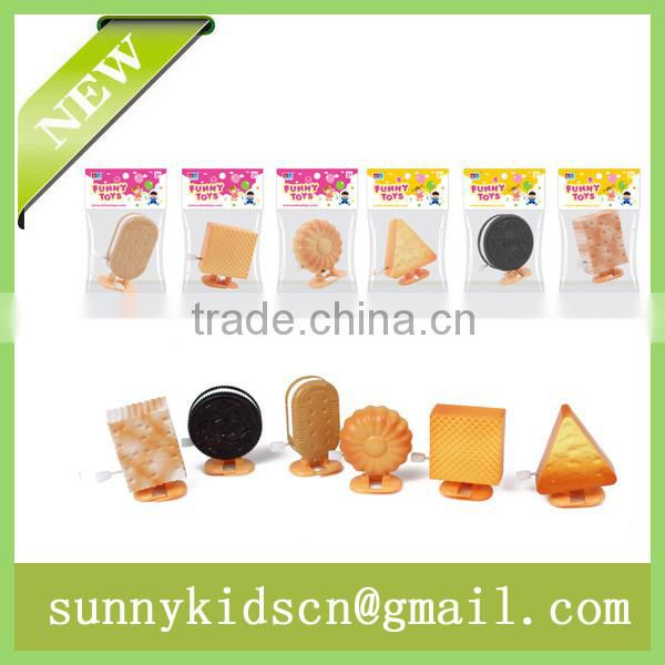 2014 HOT wind up toy wind up cookie wind up biscuit capsule toy