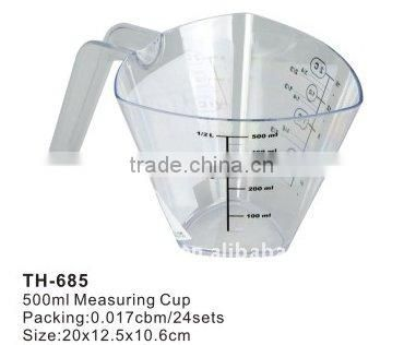 plastic measuring cup with spoons