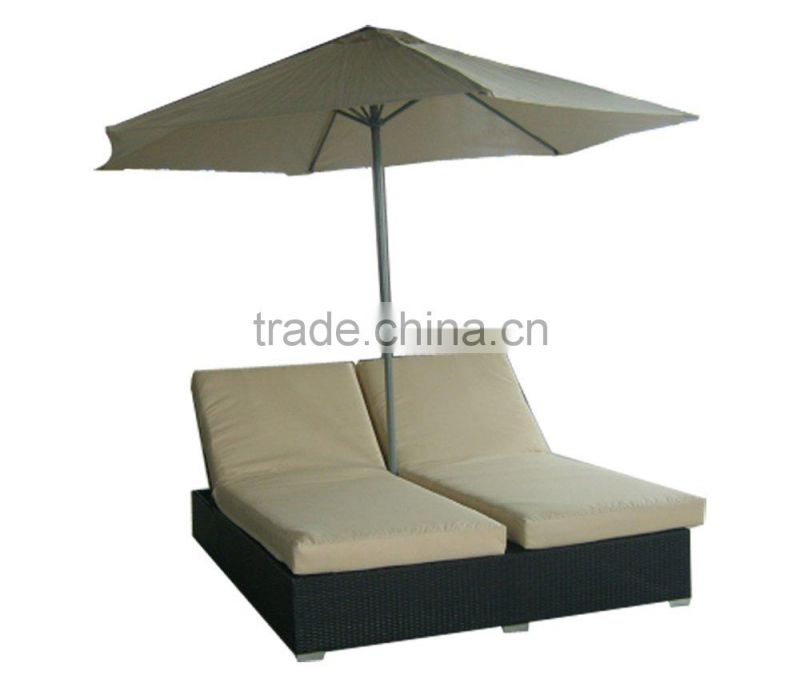 rattan beach lounge or wicker sunbed