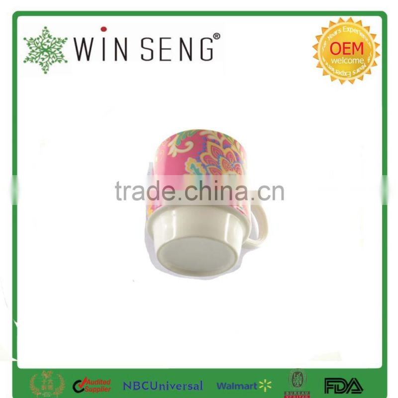 Colorful ceramic tea or coffee mug cup with ring