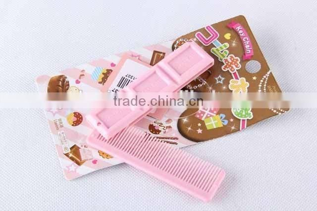 Chocolate shaped hair brush with hanging chain/folding comb