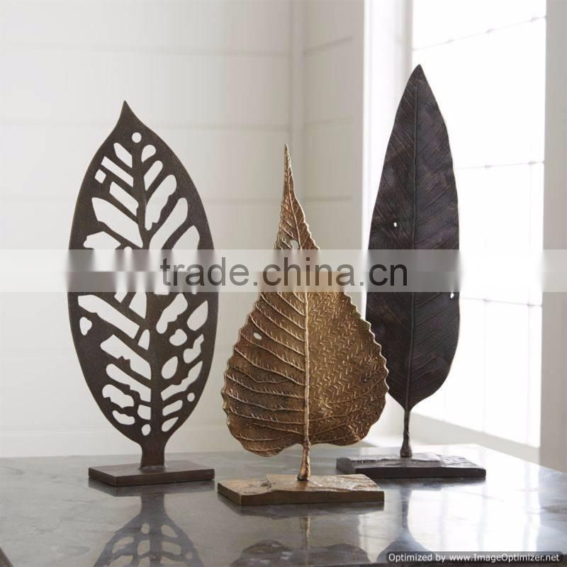 gold plated leaf with marble base unique sculpture