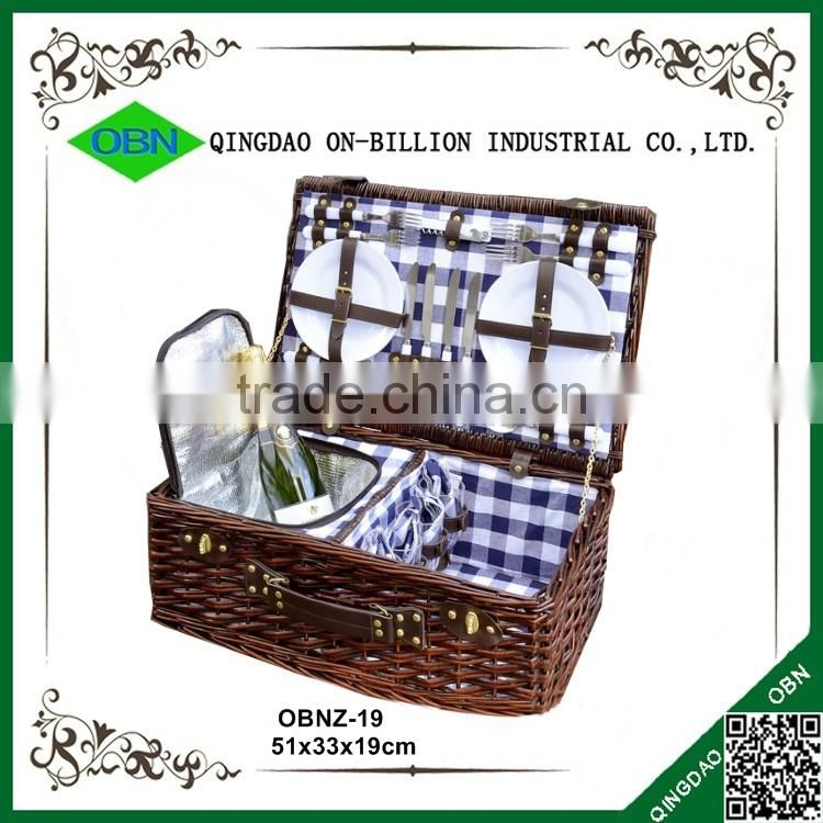 Vintage romantic wicker picnic basket for 4 person with cutlery