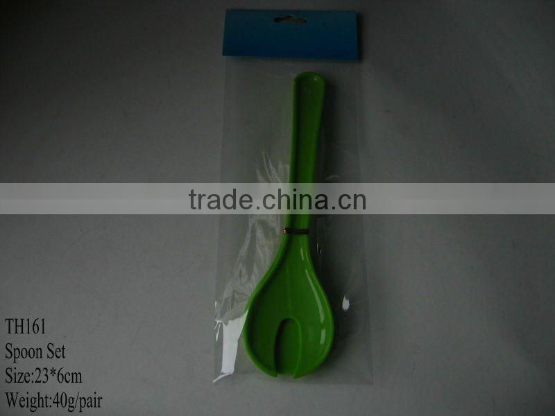 Plastic salad spoon and fork une cuillere