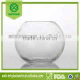 round glass vase with decorative flowers/glass fish bowl