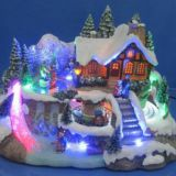 Polyresin Christmas Crafts 12'' LED Village scene with rotating train and moving skating ,eight songs music