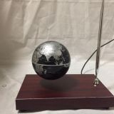 Rectangle red wooden base floating globe with a pen