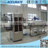 Flat Round Bottle Filling Capping And Wet Glue Wrap Around Sleeve Plastic Bag Labeling Machine
