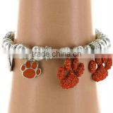 comfortable silvertone beaded stretch bracelet with crystal and enamel paw print charms
