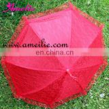 Small red doll umbrellas