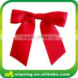 Decorative red polyester grosgrain ribbon bow