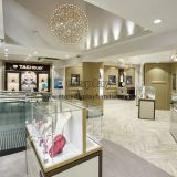 Jewellers wholesale retail store fixtures and display cabinets by wood counters with Golden stainless steel cases
