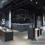 Modern Jewelry shop fitout design made by Golden Metal racks in Wood Cabinet and Pure white Panel display tables