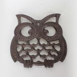 Cast iron owl table trivet