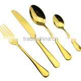 gold plated shiny antique cutlery