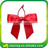Red satin ribbon bow with elastic loop