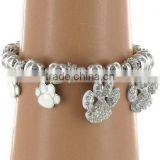 White Enamel And Rhinestone Setting Paw Print Charm Stretch Bracelet
