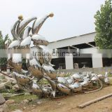 polished stainless steel dolphin statue sculpture