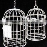 white coloure finiahed metal bird cage candle holder