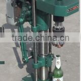 Crown cap sealing machine