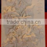 Flower wall stone relief