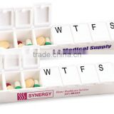 Carry Along All-Week Pill Box - features a seven-compartment capacity with printed days and comes with your logo