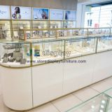 Jewellery Interior design store display wall cabinet in white painting case and golden stainless steel door frame
