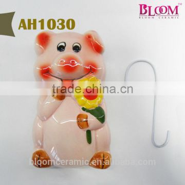 "Ceramic humidifier pig shaped with metal ""S"" hook"