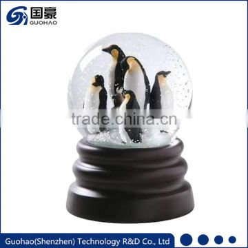 Resin penguin figurines snow globe