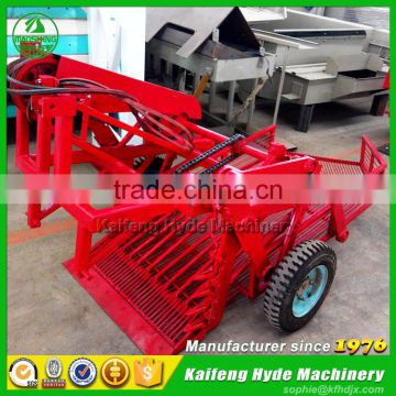 Two row peanut harvester for tractor