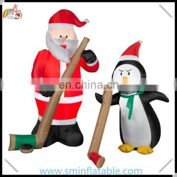 Commercial led inflatable santa claus& penguin, ice hockey game inflatable ornament, christmas outdoor display entertainment