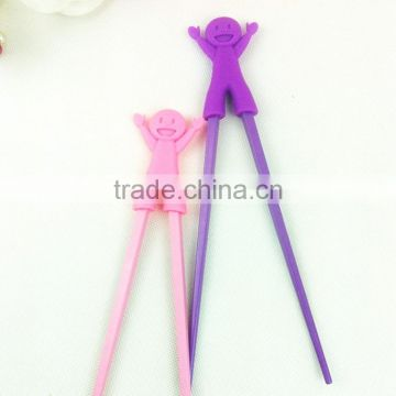 Much Funny little boy with Smiling face silicone chopsticks helpers /Fashion silicone kids chopsticks for promotion gift
