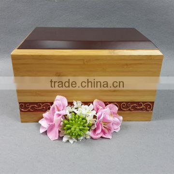 Nice traditional design bamboo adult urn with hand carved flower