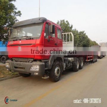 CLW 3 axle Container Trailer 60 ton with North Ben Tractor