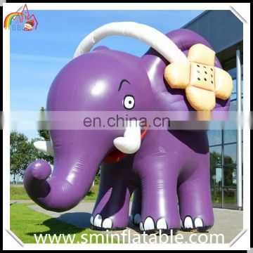 Lifelike inflatable elephant replica, inflatable elephant mascot animal with earphone for promotion