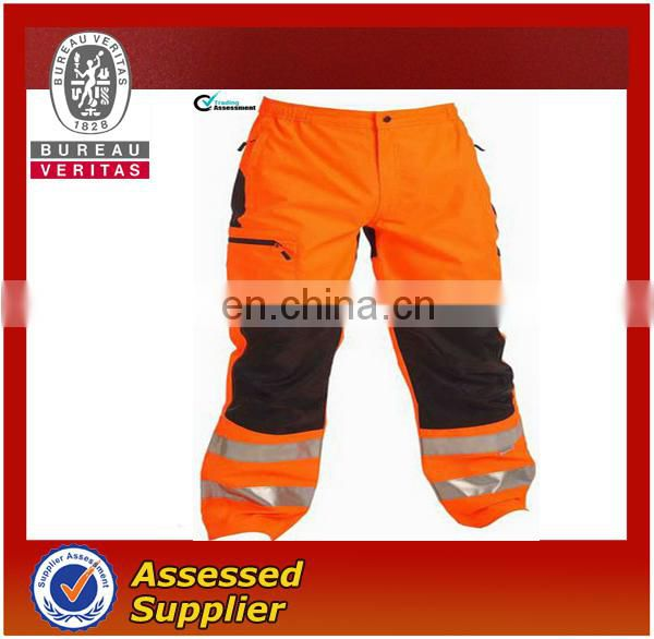 Orange safety pants with high visibility reflective tape