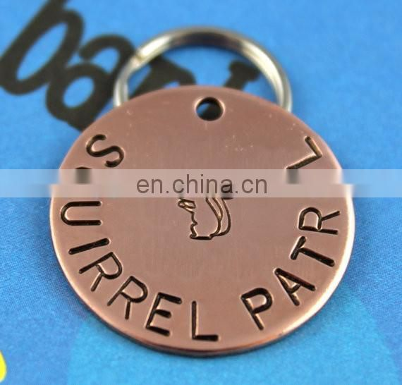 Hand stamped aluminum pet ID tags with custom design