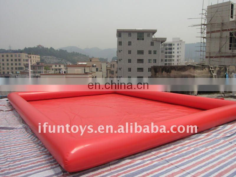 Large inflatable pool with paddle boats