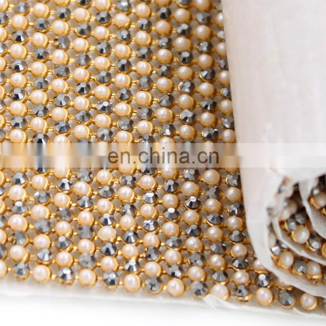 hotselling Rhinestone pearls Mesh Hot Fix Rhinestone roll Crystal Rhinestone Mesh for decoration