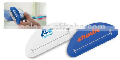 Promotional tube squeezer for toothpaste