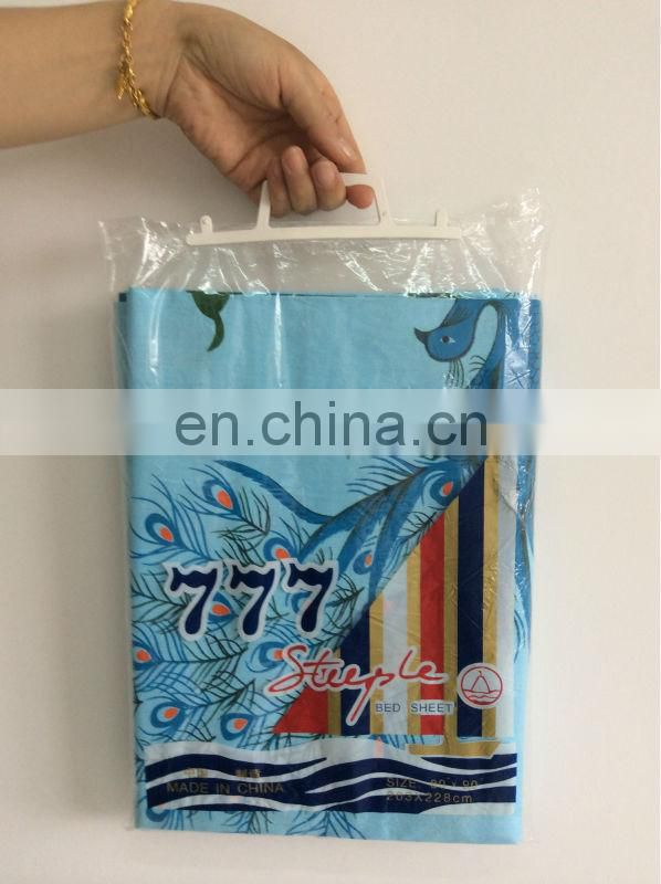 T/C printed 777 peacock bed sheet packed with a polybag handle