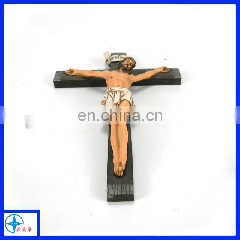 the statue of Jesus and cross for wall decoration