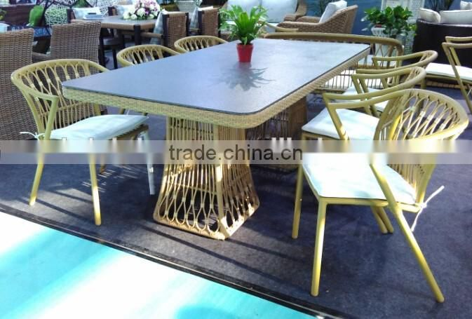 4 Person Plastic Rattan Peacock Dining Table and Chair with Cushion