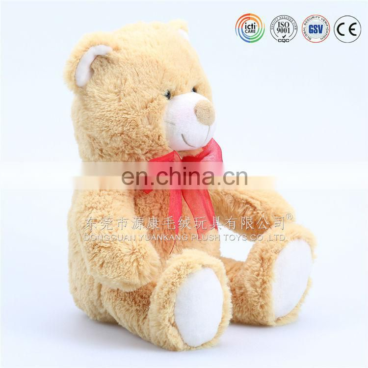 Custom plush stuffed bear holding a heart