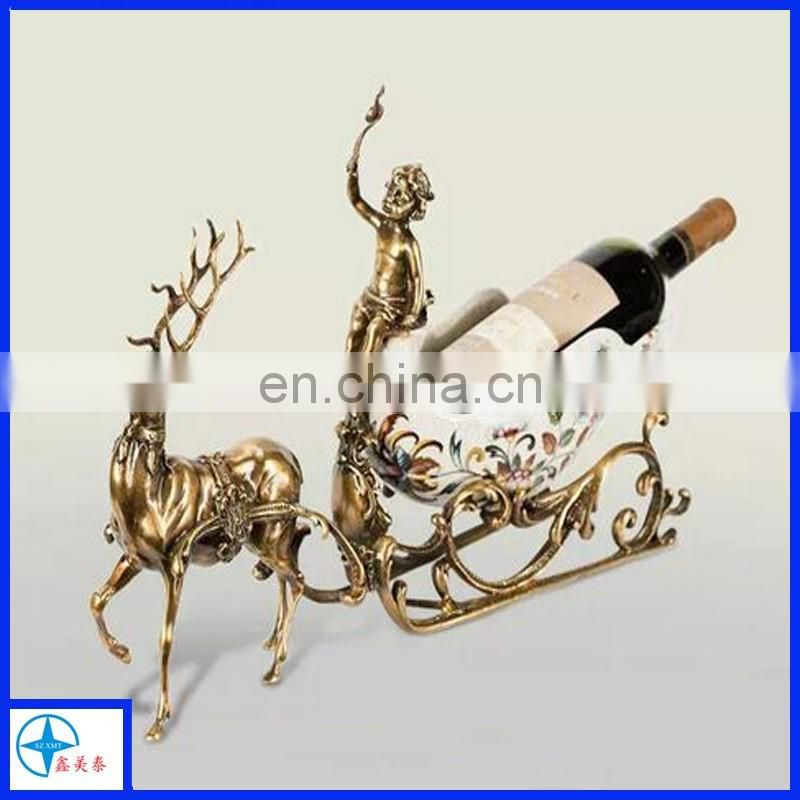 Arts & Crafts wine holder with brass reindeer sleigh, a couple decor