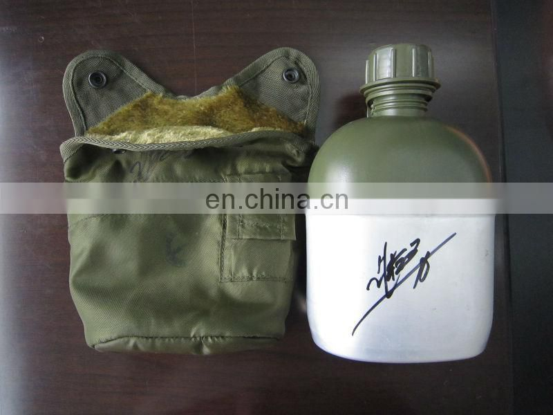US military water canteen with cover